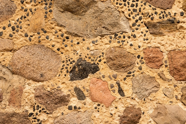 Fond de mur de pierre. modèle de roche ancienne vintage. mur de pierre.
