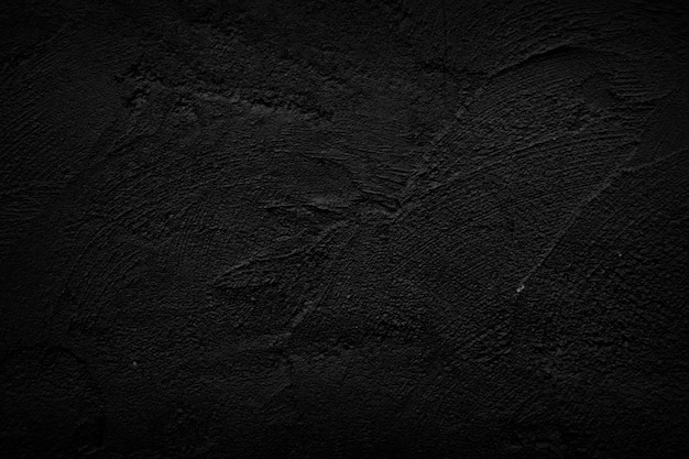 Fond de mur en pierre noire.