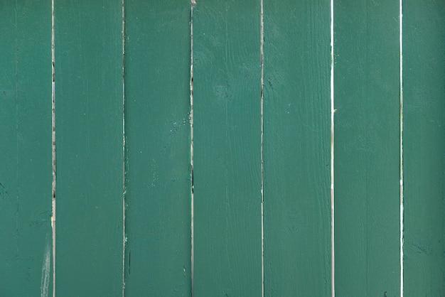 Fond de mur de planches de bois vert