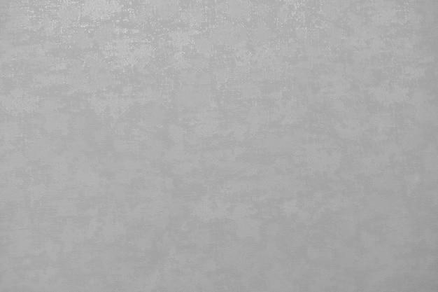 Fond de mur de plâtre nu. papier peint gris