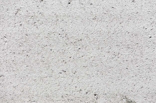 Fond de mur de stuc blanc. texture de mur de ciment peint en blanc