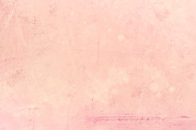 Fond de mur en stuc texturé rose