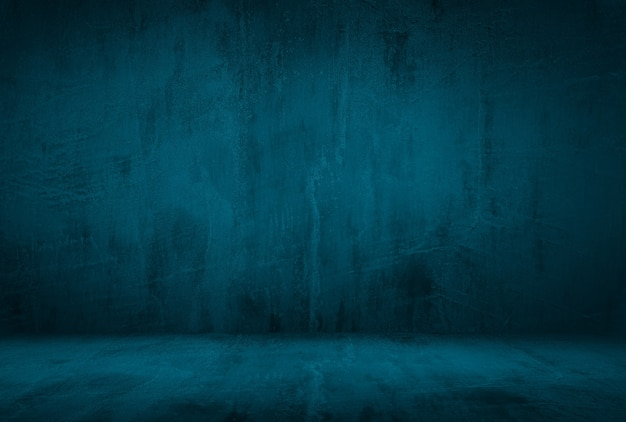 Fond de mur de studio de texture béton bleu grunge vintage avec vignette.