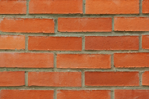 Fond de mur de texture de brique rouge. photographie horizontale.