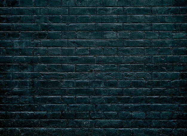Fond de mur de texture de brique sombre.