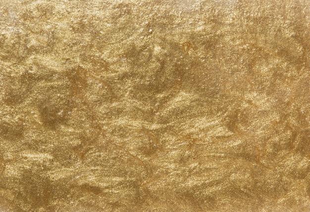 Fond de mur texturé peint en or