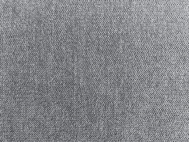 Fond de mur de texture de tissu gris foncé.