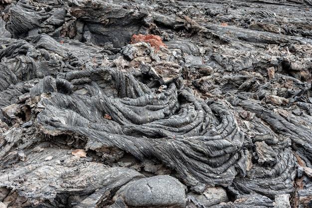 Fond naturel de lave volcanique solidifiée. pierres volcaniques froissées du kamchatka russie