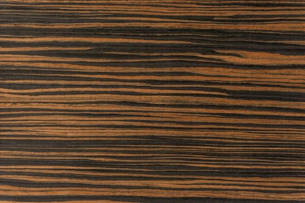 Fond naturel et surface en bois ébène.