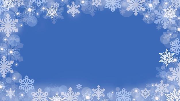 Fond de noël avec des flocons de neige sur les bords sur fond bleu.