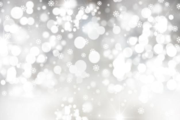 Fond de noël avec des flocons de neige et des lumières bokeh