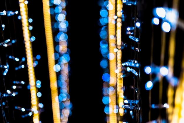 Fond noir abstrait bokeh doré et bleu