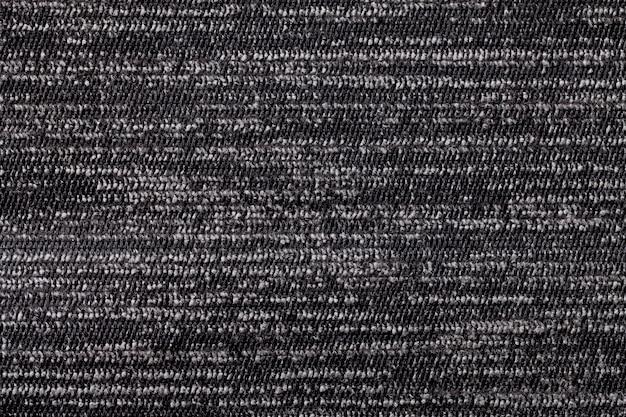 Fond noir et blanc en matière textile douce. tissu à texture naturelle.