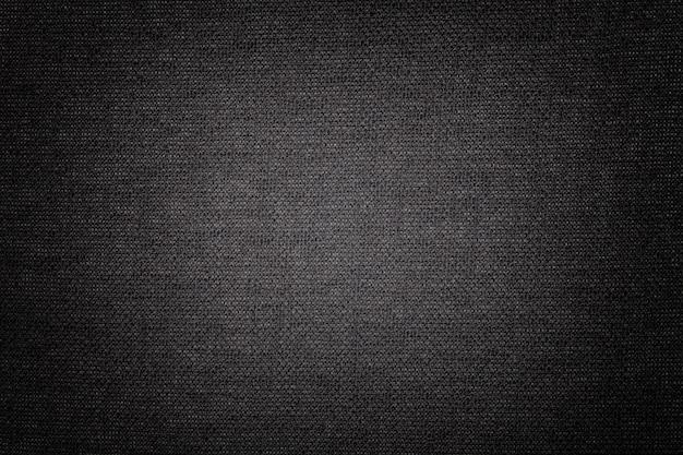 Fond noir en matière textile, tissu à texture naturelle, toile de fond,