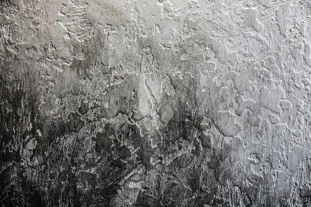 Fond noir. texture abstraite avec du plâtre de béton foncé.