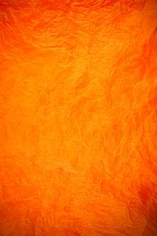 Fond obsolète texturé de papier orange vintage froissé.