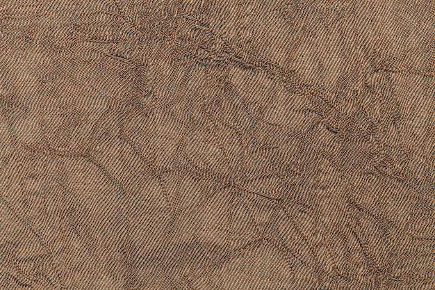 Fond ondulé brun clair à partir de matériau textile