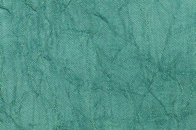 Fond ondulé de perles vert clair à partir d'un matériau textile.