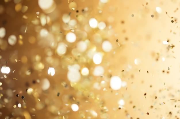 Fond d'or de noël. fond défocalisé de paillettes abstraites brillantes de vacances dorées