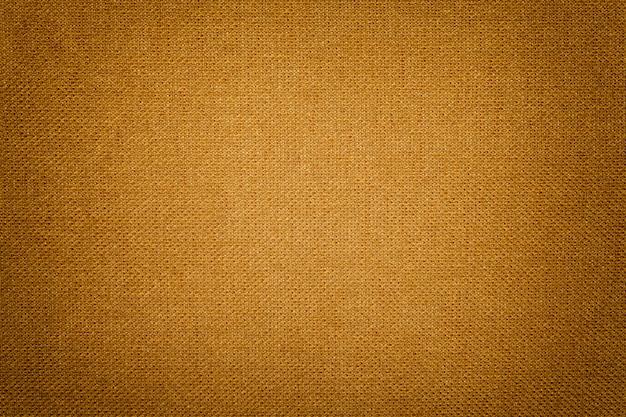 Fond orange foncé d'un matériau textile
