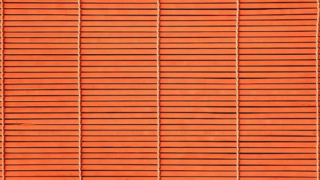Fond orange des nattes en bois.