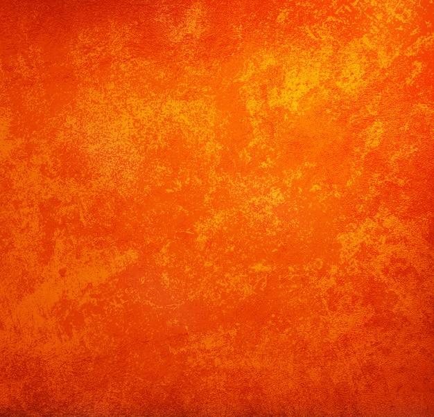 Fond orange style vintage avec fond, texture grunge.