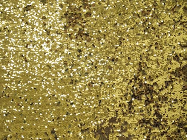 Fond de paillettes brillantes d'or.