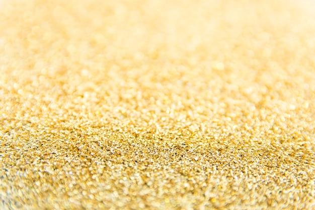 Fond de paillettes d'or défocalisé