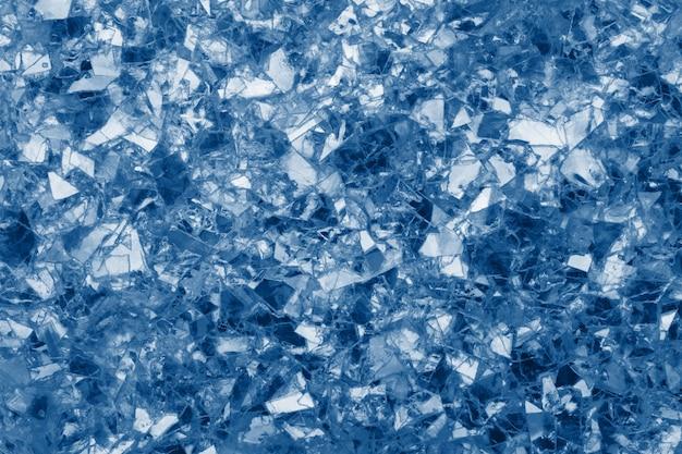 Fond de paillettes rougeoyantes bleues