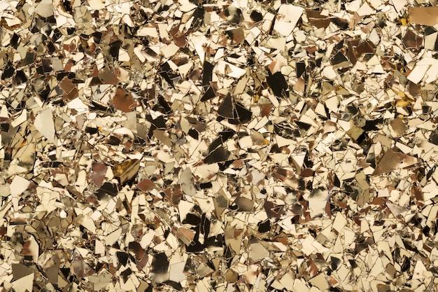 Fond de paillettes de texture de confettis de feuille d'or.