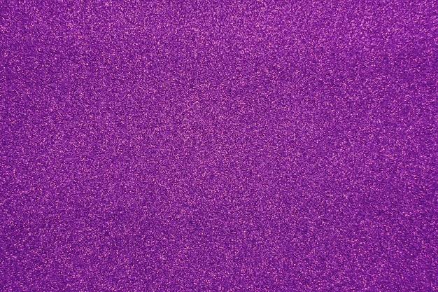 Fond de paillettes violet pour noël et plus