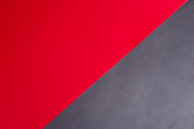 Fond papercraft en diagonale bicolore pour votre créativité couleurs noir et rouge.