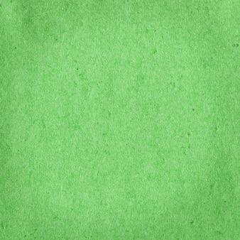 Fond de papier d'art vert. texture de grain vert. fond de papier recyclé vert