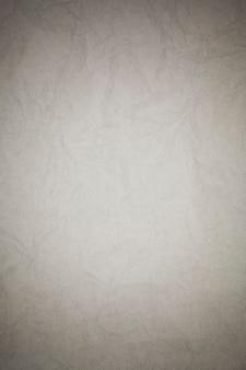 Fond de papier blanc froissé.