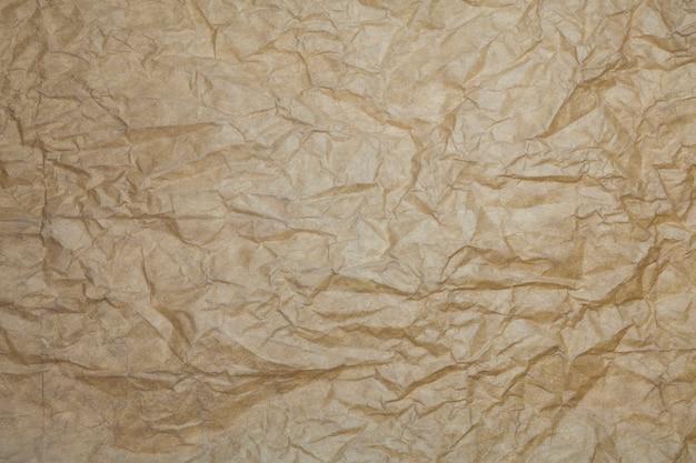 Fond de papier brun texturé.