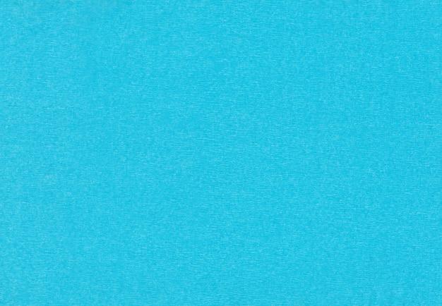 Fond de papier crépon bleu.