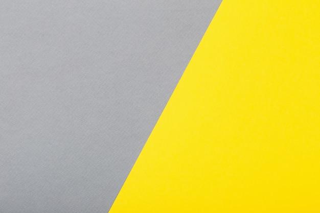 Fond de papier dans des couleurs jaunes et grises à la mode