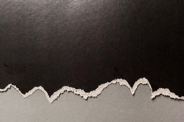 Fond de papier déchiré noir