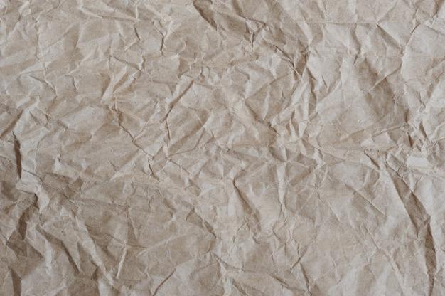Fond de papier d'emballage froissé brun