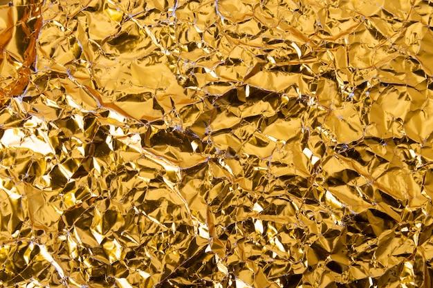 Fond de papier de feuille d'or froissé