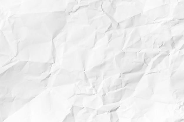 Fond de papier froissé blanc recyclé à partir d'un emballage en papier. concept de texture de papier blanc froissé
