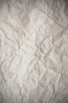 Fond de papier froissé blanc de texture.