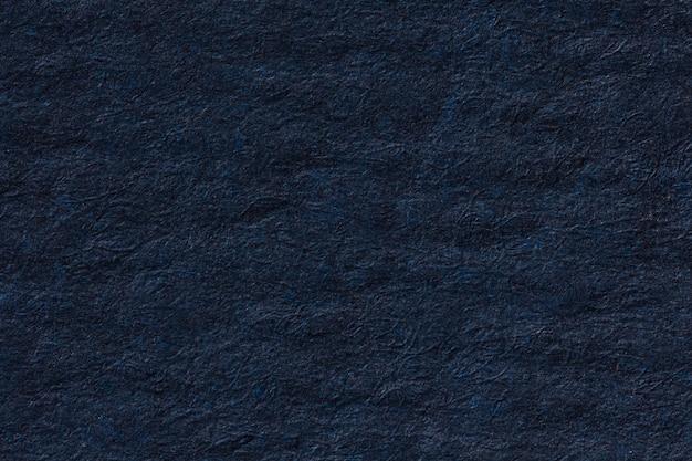 Fond de papier froissé bleu foncé. photo haute résolution.
