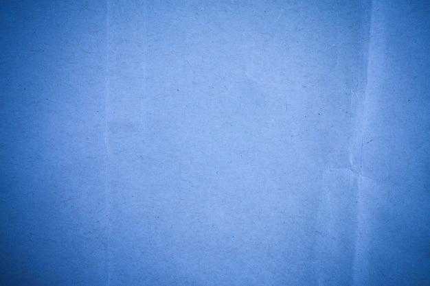 Fond de papier recyclé bleu.