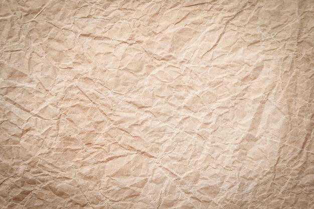 Fond de papier recyclé froissé marron