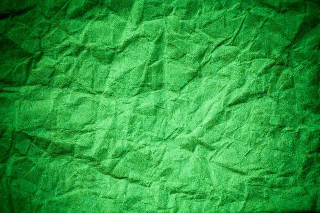 Fond de papier vert eco froissé.