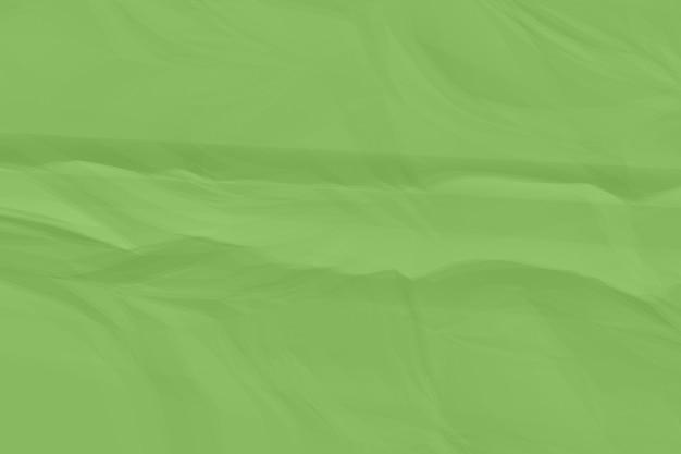 Fond de papier vert froissé se bouchent