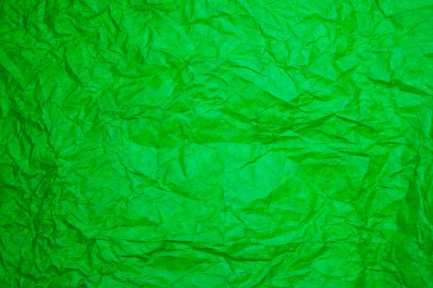 Fond de papier vert texturé.