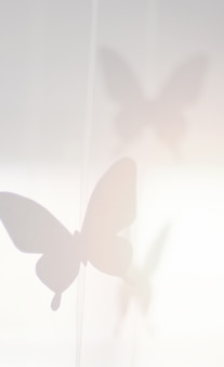 Fond de papillons de papier décoratif