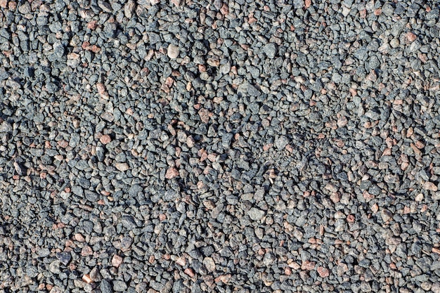 Fond de petites pierres grises pour la conception. texture de gravier